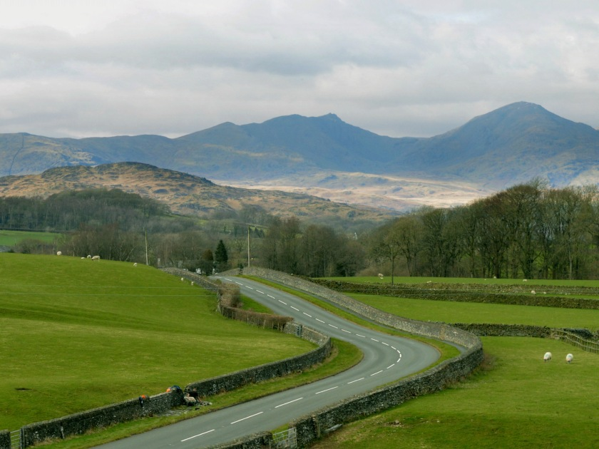 The road running through Lowick withe the Coniston Fells in the background.