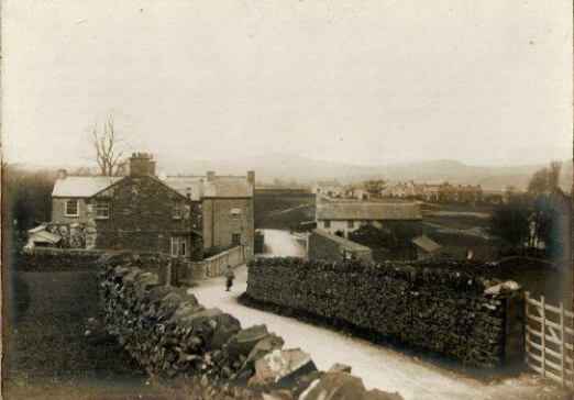 The road into Lowick Green from Penny Bridge.