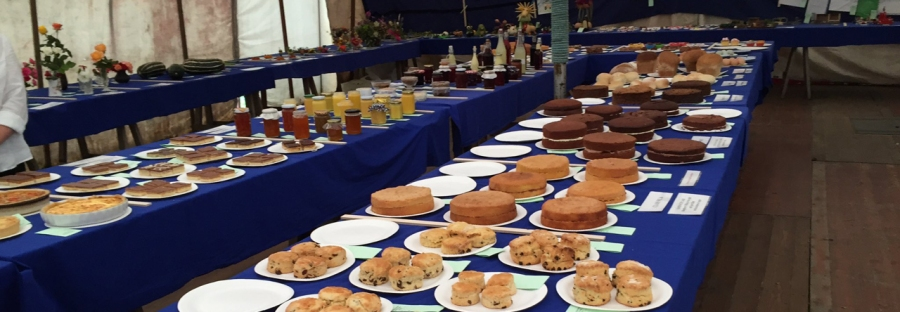 A display of cakes and jam entries at Lowick Show
